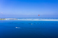 Maldives, South Male Atoll, aerial view of paraglider on the sea at an atoll - AMF06991