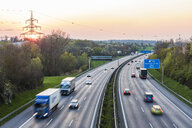 Germany, Baden-Wuerttemberg, traffic on Autobahn A8 at sunset - WDF05259
