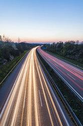 Germany, Baden-Wuerttemberg, traffic light trails on Autobahn A8 at dusk - WDF05262