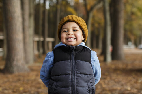 Portrait of smiling Mixed Race boy in park - BLEF02949