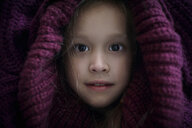 Portrait of Caucasian girl covering head with sweater - BLEF02952