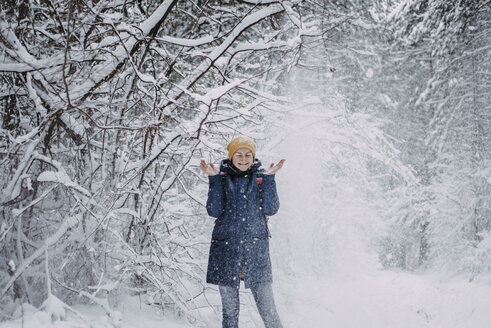 Snow falling on Caucasian woman in forest - BLEF02991