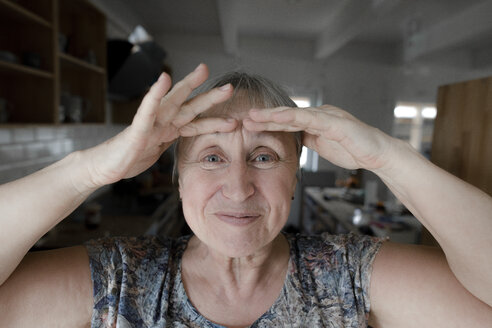 Portrait of a happy senior woman at home - KMKF00919