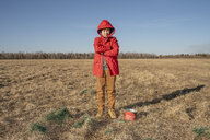 Serious boy with paint bucket in steppe landscape - VPIF01216