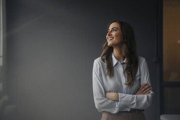 Portrait of happy young businesswoman looking sideways - KNSF05792