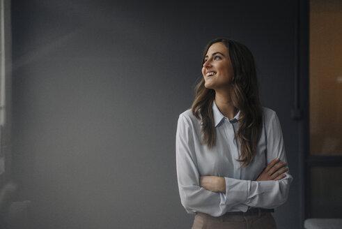 Portrait of happy young businesswoman looking sideways - KNSF05792