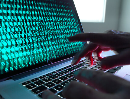 Cyber Crime, laptop computer being hacked - ISF21259
