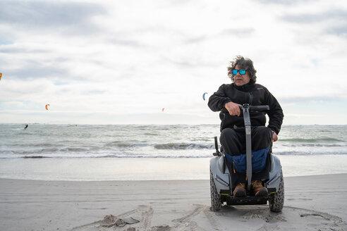 Man on wheels enjoying seaside - CUF50563