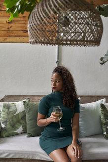 Woman enjoying a glass of white wine Botanica Mozambique, Moçambique, Maputo. - VEGF00154