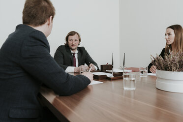 Business people having a meeting in conference room - AHSF00313