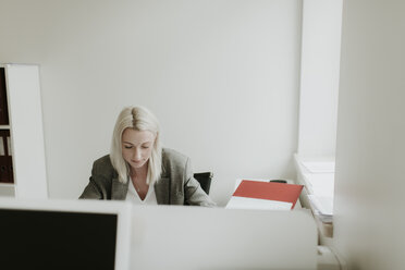 Young woman working at desk in office - AHSF00322