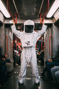 Astronaut travelling in train - CUF50678