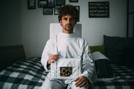 Astronaut daydreaming on bed - CUF50693