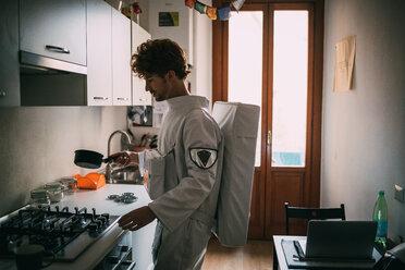 Astronaut cooking in kitchen - CUF50702