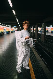 Astronaut waiting on train platform - CUF50723