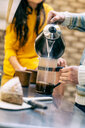 Hipster couple having coffee and talking in kitchen - CUF50984