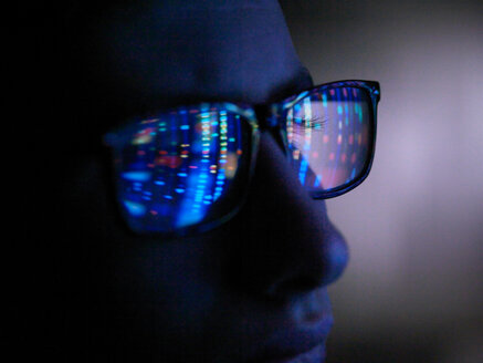 Genetic research, computer screen reflection in spectacles of DNA profile, close up of face - CUF51008