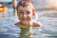 Boy playing in lake - CUF51095