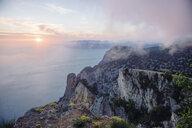 Sunrise from foggy ocean cliff - BLEF03154