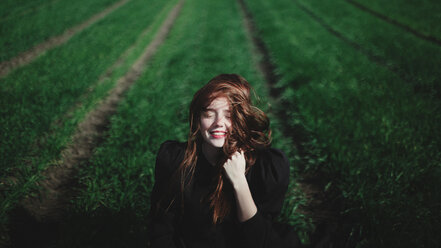 Smiling Caucasian woman in rows of grass - BLEF03241