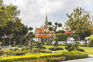 Buddhist temple, landscaped garden in foreground, Bangkok, Thailand - CUF51120