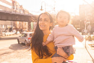 Mother and daughter exploring city, Berlin, Germany - CUF51270