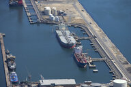 Aerial view of oil tanker moored at commercial dock - JUIF00925
