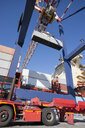 Crane unloading container ship at commercial dock - JUIF01012
