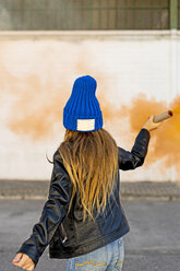 Back view of girl with orange smoke torch - ERRF01283