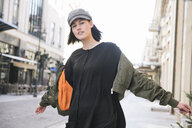 Portrait of a stylish young woman in the city - AHSF00391