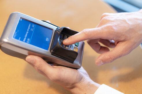 Man using credit card reader, close-up - DIGF07023