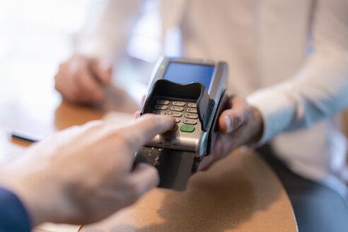 Man using credit card reader, close-up - DIGF07026