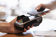 Contactless payment with smartphone, close-up - DIGF07029