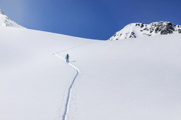 Austria, Tyrol, between Ischgl and Galtuer, Hohe Koepfe, ski tourer climbing up to the summit in winter - MMAF00933