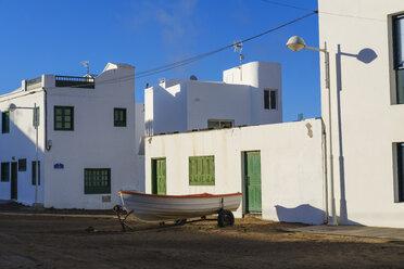Spain, Canary Islands, Lanzarote, Caleta de Famara, boat in front of residential house - SIEF08627
