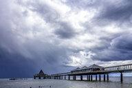 Germany, Usedom, Heringsdorf, pier under cloudy sky - PUF01430