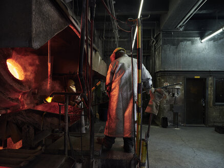 Industry, worker at furnace during melting copper, wearing a fire proximity suit - CVF01197