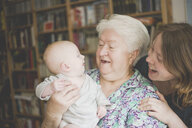 Happy grandmother with mother holding a baby girl - IHF00004