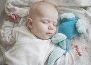 Seeping baby girl with a blue toy - IHF00016