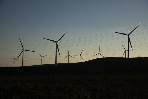 Spain, Andalusia, wind turbines at dusk - KBF00605