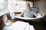 Senior male architect working in home office - HEROF36381