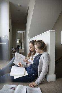 Mother helping teenage daughter with homework - HEROF36393