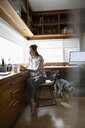 Woman working from home, using digital tablet in home office - HEROF36396