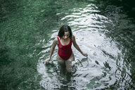 Caucasian woman wading in pool of water - BLEF03255