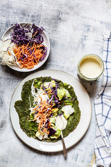 Lettuce wrap with spinach tortillas filled with lettuce, carrots and salad dressing - SBDF03958