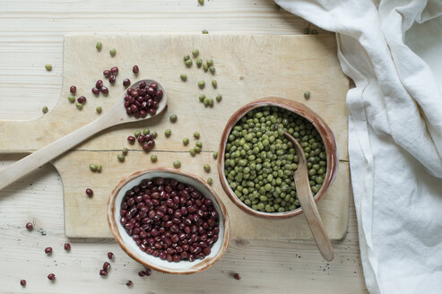 Split beans and Adzuki beans on wooden background - ASF06421