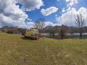 Spain, Asturias, Camposolillo, camper at Porma reservoir and Cantabrian Mountains in the back - LAF02319
