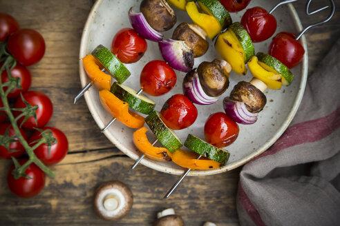 Grilled vegetable skewers on a plate and single ingredients - LVF08033