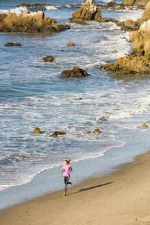 Caucasian woman running on beach - BLEF03471