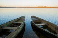 Two rowboats on lake at sunset - BLEF03555